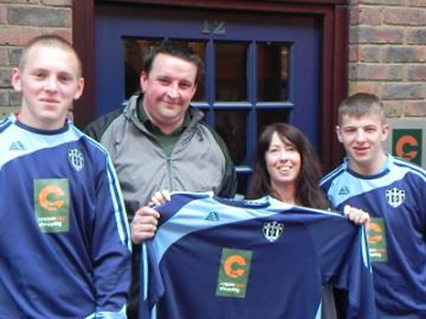 Coppergate Centre's Deb O'Donnell presents the new kit to Haxby United manager Steve Nicholson, watched by players Kieran Harris and Jason Kelly