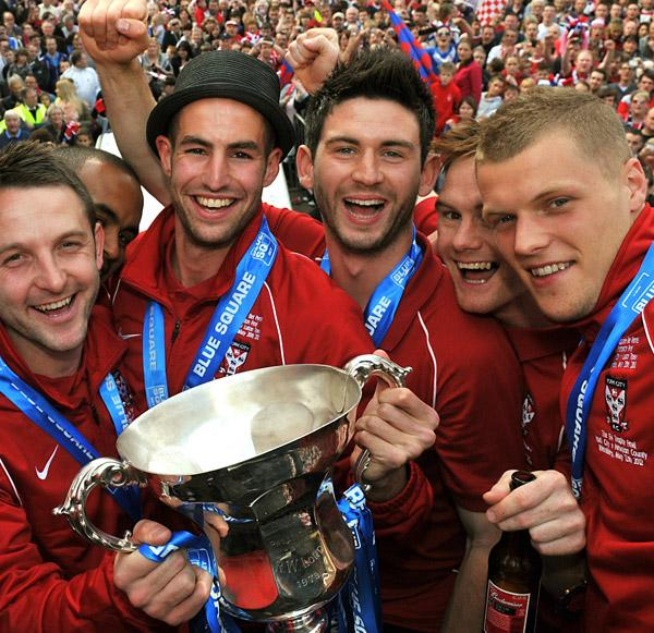 Paddy McLaughlin, centre, joins in the celebrations during York City's triumphant open-top bus tour of the city centre