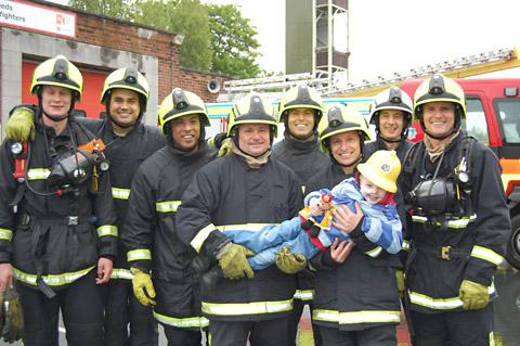 Jamie Inglis gets a helping hand from the team of firefighters of Red Watch at Gipton Fire Station