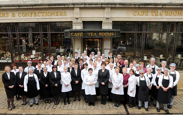 Staff from the Bettys café and tearooms in St Helen's Square, York, gather for a picture to mark their 75th anniversary
