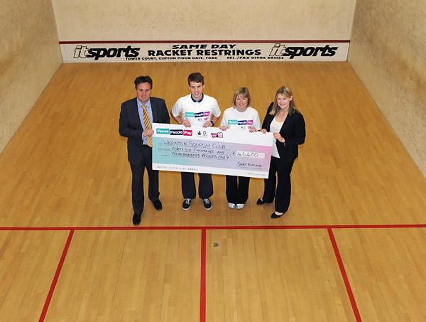 Julian Sturdy, left, presents a cheque for £46,000 of Olympic legacy funding from Sport England's Inspired Facilities Fund to Wigginton Squash Club player Neil Cordell and club  chairwoman Linda Pepper, watched  by Lizzie Hughes, right, of Sport Englan