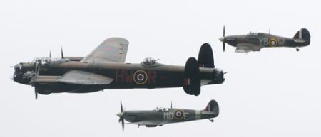 A Spitfire, Hurricane and Lancaster roar over the National            Railway Museum at the start of  Railfest 2012