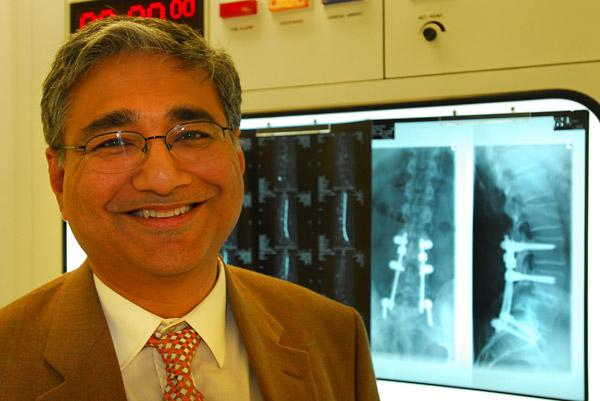 Manoj Krishna, a consultant spinal surgeon, who believes early treatment offers the best results for back pain