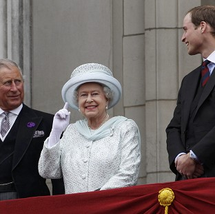York Press: The Queen gestures on the balcony of Buckingham Palace during the Diamond Jubilee celebrations