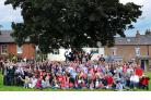 Our photographer, Anthony Chappel-Ross, captured this picture of Tollerton residents on the village green before the official photo was taken by Richard Llewellyn