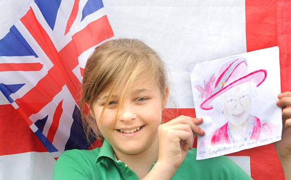 Mia Richardson with her winning portrait of the Queen