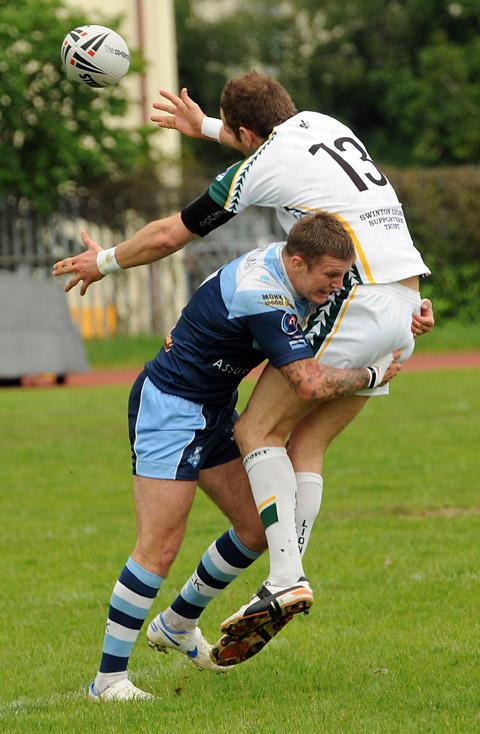 York City Knights player Danny Nicklas, left crunches into a juddering tackle on Swinton Lions player Chaz L'Anson