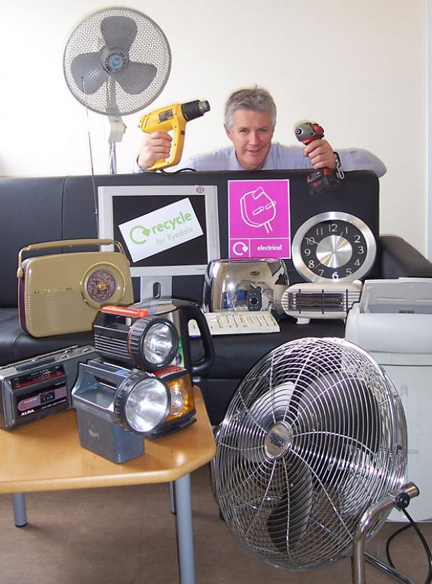Ryedale District Council's recycling officer John Brown with some electrical items which can be recycled