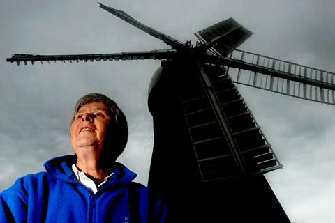 Jen Hay, of the Holgate mill preservation society, in the shadow of the mill's sails