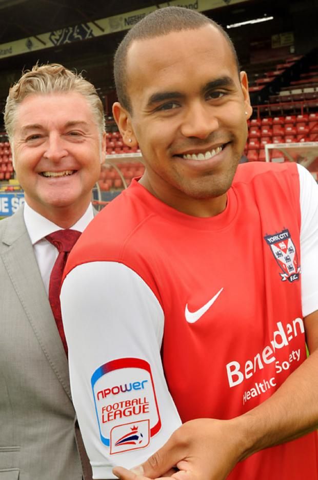 Ashley Chambers models the new York City shirt, watched by chairman Jason McGill