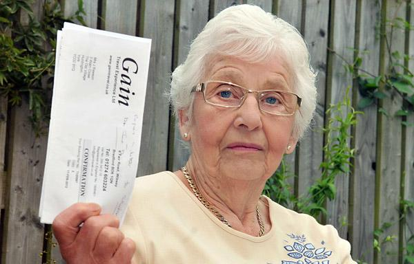 York pensioner Joyce Rawson with her letter from Gain Travel informing her that the firm has ceased trading