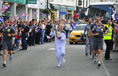 Rachel Keil-isaac carries the Olympic Flame on the Torch Relay leg through Selby.
