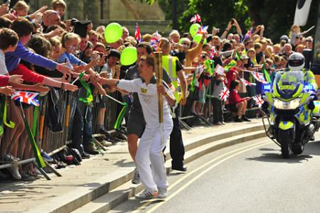 Jacob Taylor carries the Olympic Flame on the Torch Relay leg through Selby
