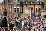 The Olympic torch comes over Lendal Bridge .
