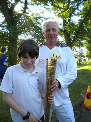 A torchbearer in York with Tyler Simpson. Picture: Alison Simpson