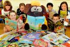 Frankie & Benny's  mascot Sketch and pupils of Fishergate Primary School read some of the books presented to the school which were  funded by the restaurant