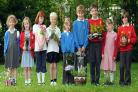 The work of pupils in the gardening challenge at Dunnington Primary School has brightened up the village
