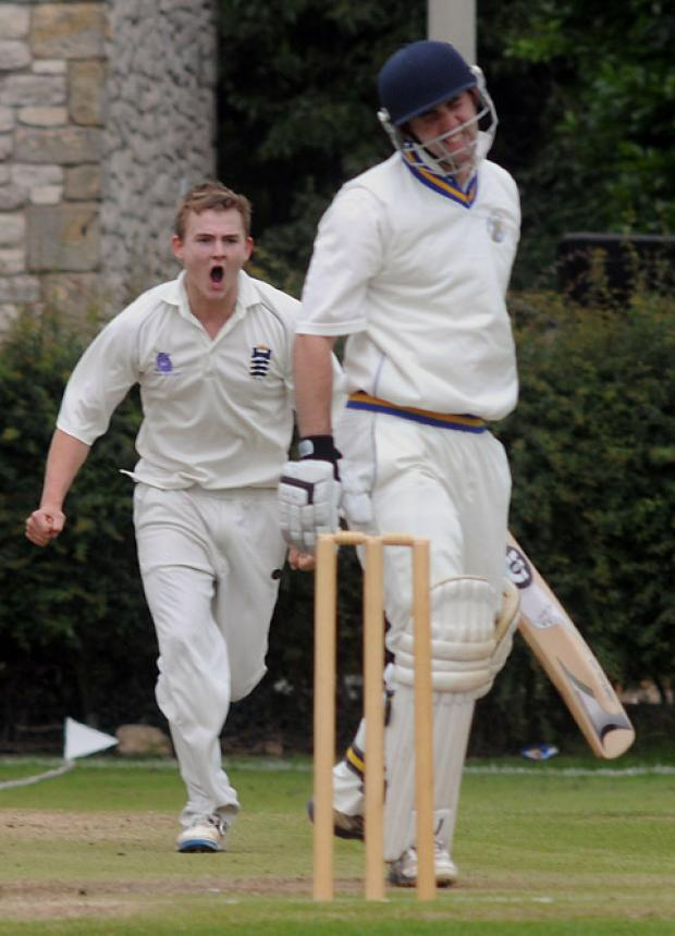 Pickering paceman George Barker roars his approval after Thirsk batsman Mark Cook is caught at slip