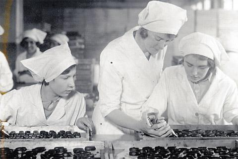 Learning the art of hand piping chocolates, left, at the Rowntree factory in 1933
