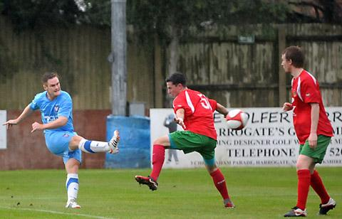 Jason Walker curls in the first of his hat-trick of goals
