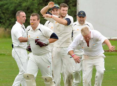 Hemingbrough bowler Glen Crouch, centre, celebrates another scalp