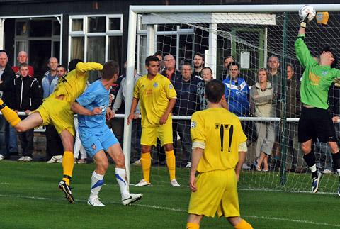 York City's Lee Bullock sees his header tipped over the bar by Pickering 'keeper Arran Reid