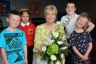 Burton Green Primary School's retiring head teacher, Sally Taylor, with some of the pupils, from left, Kaiden, Natasha, Jake and Lily