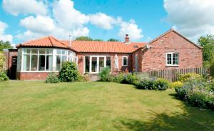 Byre Cottage is a delightful barn conversion with a large and elegant living room and spacious conservatory