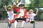 Pocklington Montessori School pupils enjoy ringing their bells and shaking other   musical instruments with town crier Geoff Sheasby