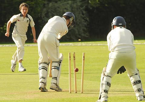 York's Cameron Lynde is clean bowled by Acomb's Ollie Fryer