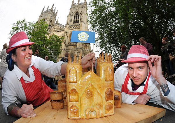 Nell Weavill and Jacob Noble, of Hinchcliffe's, with their Pork Minster, in the shadow of the real York Minster