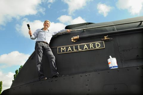 Steve Davies ,Director of the National Railway Museum with the black Mallard.