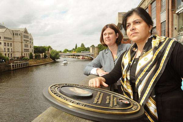Conservative Party Chairman Baroness Sayeeda Warsi, right, and Conservative Police and Crime Commissioner candidate Julia Mulligan stand by the plaque to the memory of Richard Horrocks who died trying to swim across the River Ouse