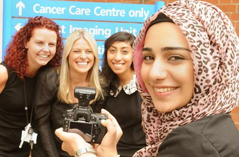 Reman Sadani, 16, photographs, from left, Michelle Kirkman, Jane Archer and Monica Birdi from the York Hospital Cancer Care Centre as she launched her Give York a Smile project