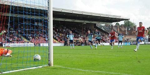 York City striker Jamie Reed nets from the penalty spot in Saturday's 2-1 friendly defeat by Middlesbrough at Bootham Crescent