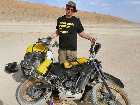 Kevin Strickland with his broken bike in Turkmenistan