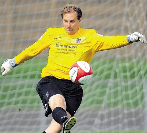 Goalkeeping coach Paul Musselwhite, pictured above in pre-season friendly action, is  tipping York City shot-stopper Michael Ingham for a Northern Ireland recall this season