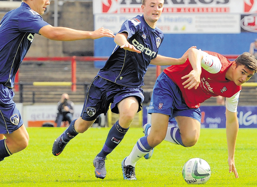 York City youngster Tom Platt in pre-season action against Oldham Athletic