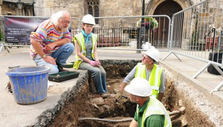 Prof Mick Aston visited an archaeological dig at York's Guildhall and Mansion House