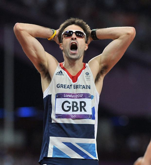 Great Britain's Martyn Rooney shows his dejection after missing out on a medal in the Men's 4x400m relay at the Olympic Stadium