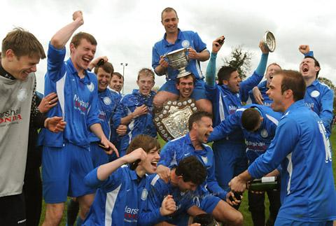 Old Malton St Mary's celebrate their Senior Cup conquest with player-manager Darren Dunning, second from right