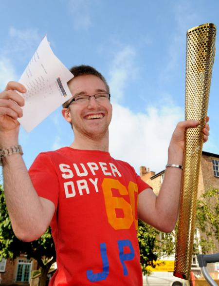 Jamie Green, from Malton, who carried the Olympic torch through Scarborough, celebrates achieving top A-level grades