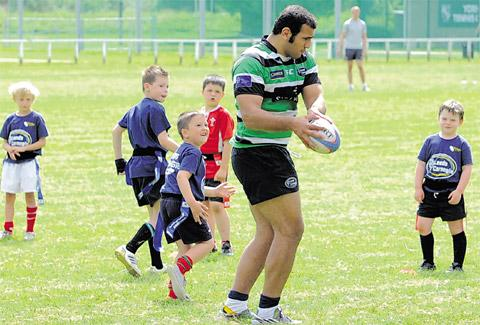 Youngsters are put through their paces by prop Sam Lockwood at a Leeds Carnegie summer rugby union camp at York RUFC's Clifton Park. Carnegie are in Selby next week