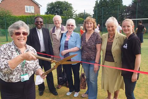 Coun Ann Spetch cuts the ribbon to officially open the new all-weather play area in Camblesforth