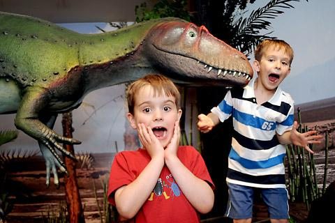 Gregor and Hamish Frazer with one of the dinosaurs at the Rotunda Museum in Scarborough