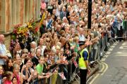 Spectators line Duncombe Place to catch sight of the  Paralympic Lantern