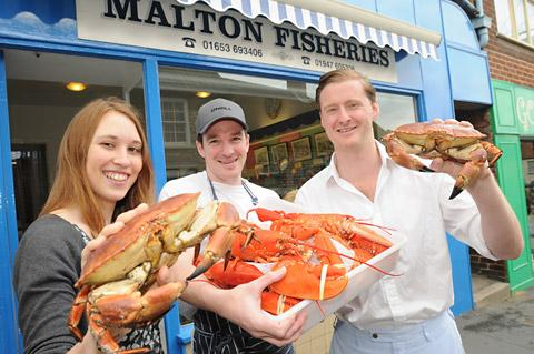 Alexia Williams joins  Mark Waller of Malton Fisheries, and Tom Naylor- Leyland, to get ready for  the Malton Food Lovers Market