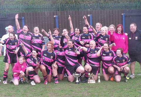 York Ladies celebrate victory in this year's Women's Amateur Rugby League Association Challenge Cup Plate final, with coach Phil 'OJ' Johnson, far right