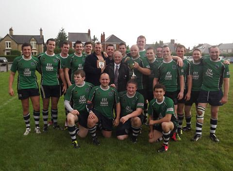 Yorkshire RFU  president Steve Watson,  centre, hands over a brace  of trophies to Pocklington