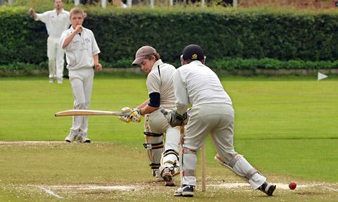 Hemingbrough batsman James Dougherty looks back  anxiously as the ball spins past Bishopthorpe  wicket-keeper Ben Smith after a  delivery from bowler Andrew Seager